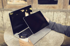 Woman with blank digital tablet, laptop and cup of coffee outdoo Royalty Free Stock Photo