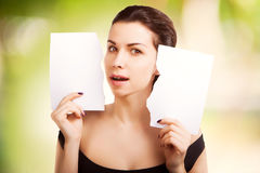 Woman with  blank empty paper billboard with copy space f Stock Image