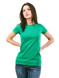 Woman with blank green shirt stock image