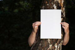 Woman with blank paper outdoor. Tree Stock Photos