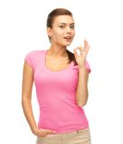 Woman in blank pink t-shirt showing ok gesture Royalty Free Stock Image