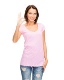 Woman in blank pink t-shirt showing ok gesture Stock Photo