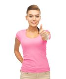 Woman in blank pink t-shirt showing thumbs up Royalty Free Stock Photos
