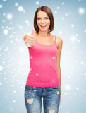 Woman in blank pink tank top showing thumbs up Royalty Free Stock Photo