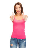 Woman in blank pink tank top showing thumbs up Stock Photos