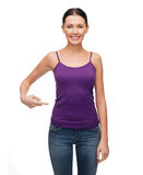 Woman in blank purple tank top pointing at herself Stock Photography
