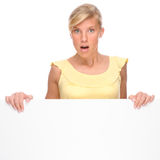 Woman with blank sign. Full isolated portrait of a beautiful woman with blank sign Stock Photo