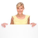 Woman with blank sign. Full isolated portrait of a beautiful woman with blank sign Royalty Free Stock Photography