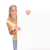 Woman with blank sign. Full isolated portrait of a beautiful woman with blank sign Royalty Free Stock Image