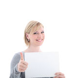 Woman with blank sign gives thumbs up Stock Image
