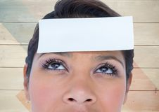 Woman with blank sticky note on forehead Royalty Free Stock Photography