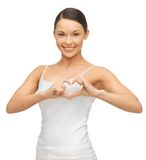 Woman in blank t-shirt. Picture of woman in blank t-shirt forming heart shape Royalty Free Stock Image