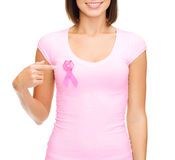 Woman in blank t-shirt with pink cancer ribbon stock images