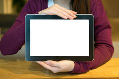 Woman and blank tablet in coffee shop. Blank tablet useful for put some text Royalty Free Stock Photography