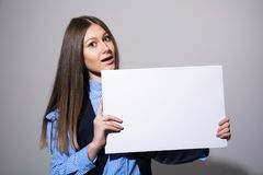 Woman with a blank white banner Royalty Free Stock Photo