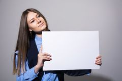 Woman with a blank white banner Royalty Free Stock Photos