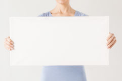 Woman with blank white board Stock Photo