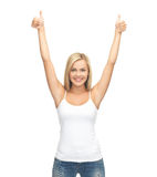 Woman in blank white t-shirt. Picture of happy woman in blank white t-shirt showing thumbs up Stock Images