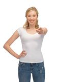 Woman in blank white t-shirt pointing her finger Royalty Free Stock Photos