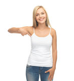 Woman in blank white t-shirt pointing at herself Royalty Free Stock Photo