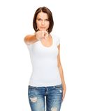 Woman in blank white t-shirt pointing at you Royalty Free Stock Photography