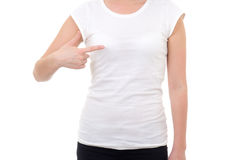 Woman in blank white t-shirt showing at herself isolated on whit Royalty Free Stock Photos