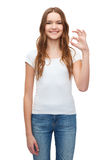 Woman in blank white t-shirt showing ok gesture Stock Photo
