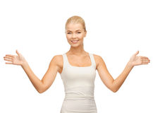 Woman in blank white t-shirt showing open palms Royalty Free Stock Photos