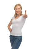 Woman in blank white t-shirt with thumbs up Stock Photos