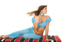 Woman on blanket in blue hair blow look back Royalty Free Stock Photography