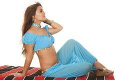Woman on blanket in blue hair blow look side Stock Photo