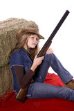 Woman on blanket holding gun Stock Photos