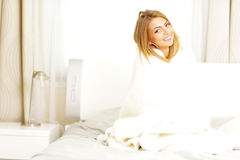 Woman with blanket at home Stock Images