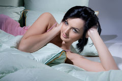 Woman, Blanket And Pillows. Young beautiful woman lying with down pillows and blanket stock photos