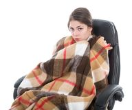 Woman with blanket sitting in armchair, isolated over white. Woman with blanket sitting in armchair, isolated at white background Royalty Free Stock Photos