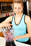 Woman blender Stock Images
