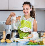 Woman with blender at kitchen Stock Image