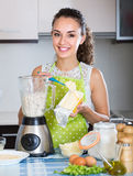 Woman with blender at kitchen Royalty Free Stock Photos