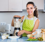 Woman with blender at kitchen Royalty Free Stock Images
