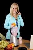 Woman blender phone orange Royalty Free Stock Image