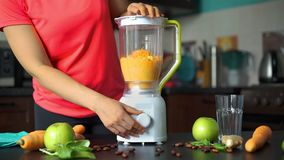 Woman Blending Carrot and Apples to Make Smoothie. In the Kitchen. Healthy Lifestyle, Weight Loss Food and Nutrition Concept stock footage