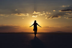 Woman blessing the sunset Royalty Free Stock Photography