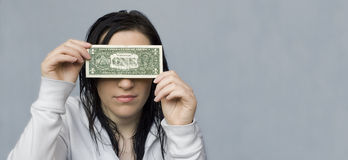 Woman blinded by money Royalty Free Stock Photos