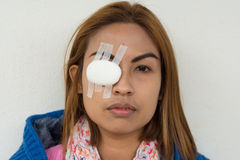 Woman blindfolded with eye pad Stock Photos