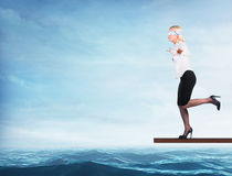 Woman blindfolded walking on a board Stock Photos