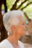 Woman in bliss. Profile of mature caucasian woman with blissful look on her face Royalty Free Stock Photography
