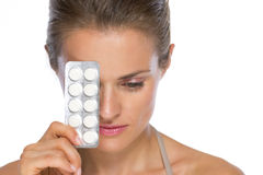 Woman with blistering package of pills Stock Photos