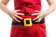 Woman with bloated stomach grabbing abdominal area. As flatulence and constipation concept after Christmas and holidays dinner Stock Images
