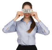 Woman blocking the face of hundred dollar bills Royalty Free Stock Image