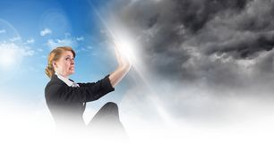 Woman blocking Grey sky and blue sky weather change surreal transition. Digital composite of Woman blocking Grey sky and blue sky weather change surreal royalty free stock photos